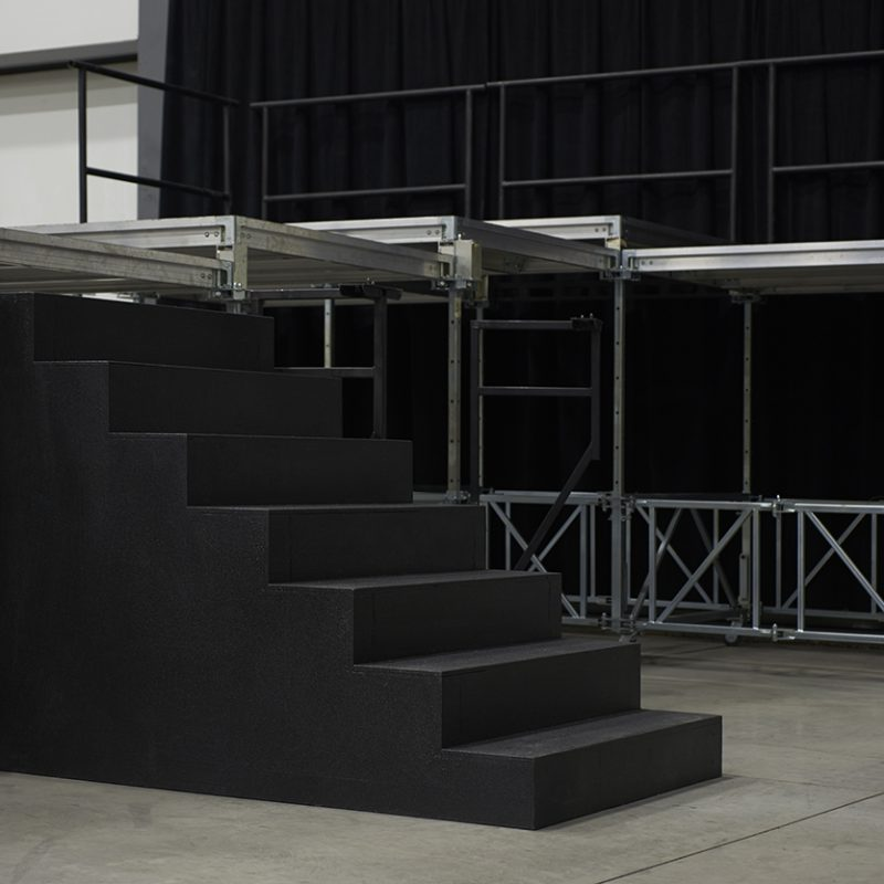 Stage with stairs and gardrails